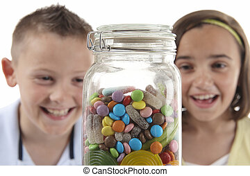 Girl & boy looking at sweet jar