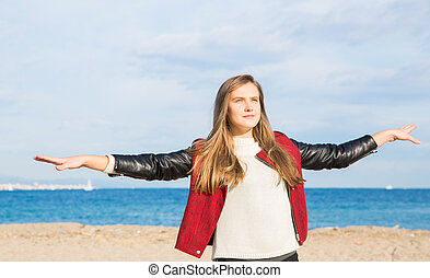 Girl breathing deeply at the beach on a sunny day