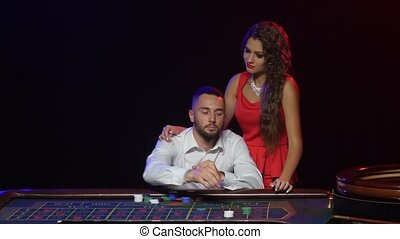 Girl brings good luck to man in game of roulette