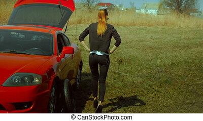 girl broke the wheel of the car