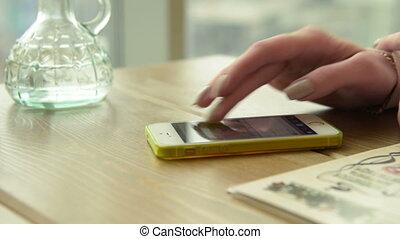 Girl browsing social media on mobile phone