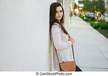 girl brunette on the street