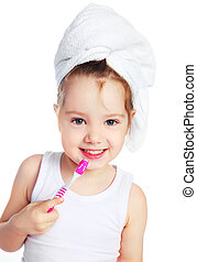 girl brushing teeth - cute little girl with a towel on her...