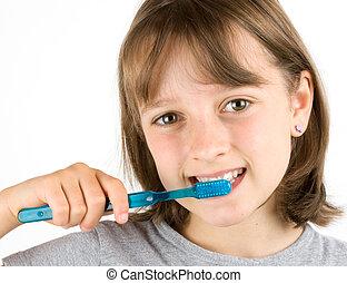 Girl Brushing Teeth - Girl brushing her teeth against a ...