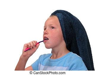 Girl Brushing Teeth - Nine year old girl with towel on her ...