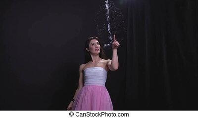 Girl bursting soap bubble - Woman with soap bubbles, bullet...