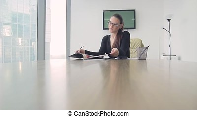 girl business lady in the office in a skyscraper