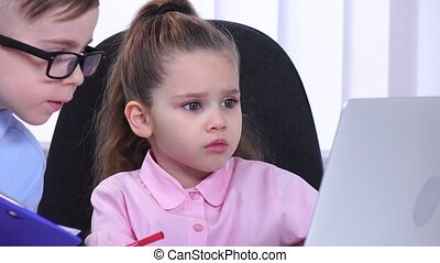 Girl businessman sitting in the office with his subordinates and communicate