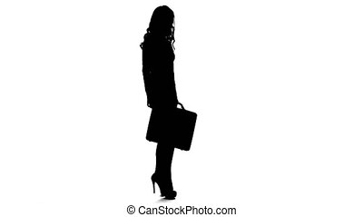 Girl businesswoman in high heels with a briefcase in hands. White background. Silhouette