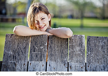 Girl by the fence