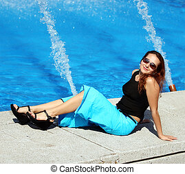 Girl by the pool