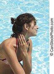 sun burn - girl by the swimming pool with sun burn