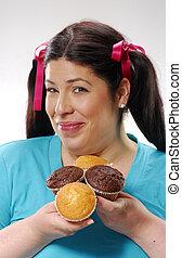 Girl eating vanilla cake Happy cute girl eatingt vanilla stock