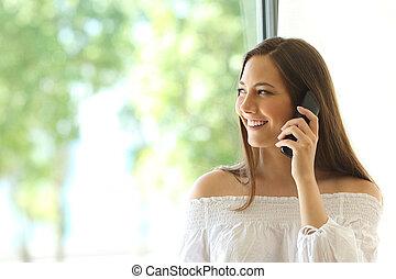 Girl calling on phone landline at home - Girl calling on ...