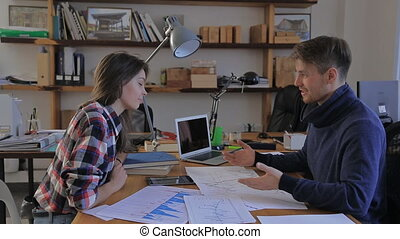 girl came to his financial adviser. charts, analysis, annual reports, consultation in the office.