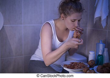 Girl can not control hunger - Photo of girl with bulimia can...