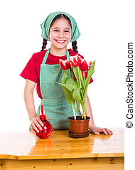 Girl care flowers in pot