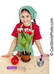 Girl care flowers on the desk
