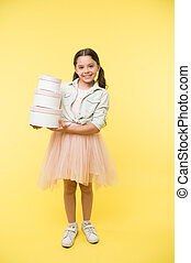 Girl carries pile boxes. Prepare shopping sale season. Prepare for school season buy supplies stationery clothes in advance. Back to school season great time to teach budgeting basics children