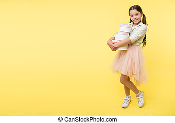 Girl carries pile boxes. Save money shopping sale season. Back to school season great time to teach budgeting basics children. Prepare for school season buy supplies stationery clothes in advance