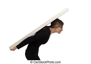 girl carrying a huge weight - a beautiful girl carrying a...