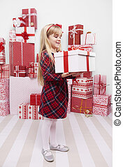 Girl carrying heavy Christmas present