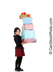 girl carrying pile christmas gifts