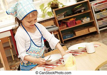 Girl catering service - little girl serving foor breakfast...
