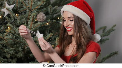 Girl Checks out Christmas Ornament - Curious girl with...