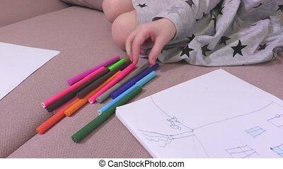 Girl checks the drawing stuff