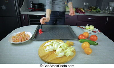Girl chef preparing raw chicken meat on baking sheet - Girl...