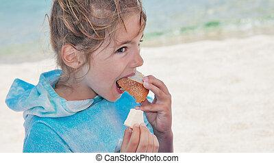 Girl Child Eating Beach Bread