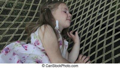 Girl child in a hammock
