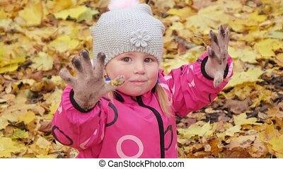 Girl child in dirty gloves