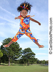 Girl Child Jump - Six year old girl in colorful summer...