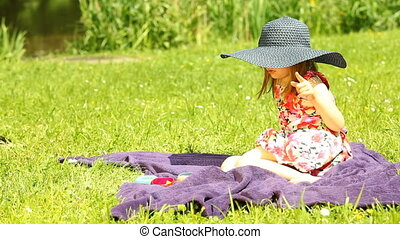 Girl child kid relaxing on meadow
