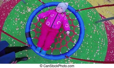 Girl child on rotating swing - Chair of the rotating swing...