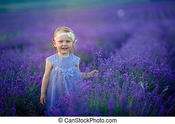 Girl child outdoor summer in natural flower field