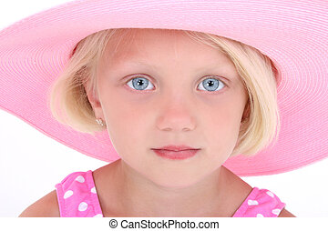 Beautiful Little Girl In Pink Swim Suit And Large Hat. Close-up with serious expression. Shot in studio over white with the Canon 20D.