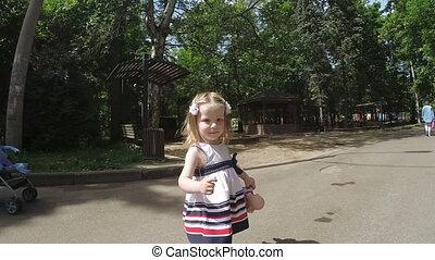 Girl child running on park
