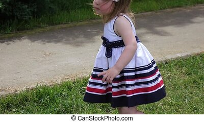 Girl child running on the lawn