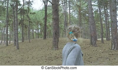 Girl child runs through the forest - Girl child running...