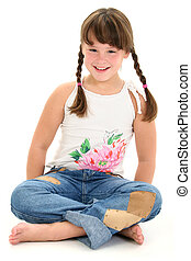 Girl Child Sitting - Little girl in braids sitting barefoot...