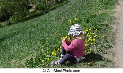 girl child sowthistle - Small blond girl child sit on ground...