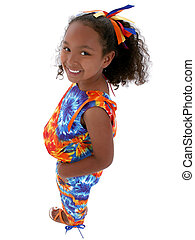 Beautiful six year old girl in bright colors standing isolated on white. Shot with the Canon 20D.