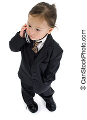 Japanese American 2 year old girl in suit with cellphone.
