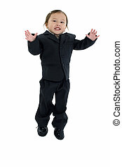 Two year old Japanese American girl in business suit jumping.