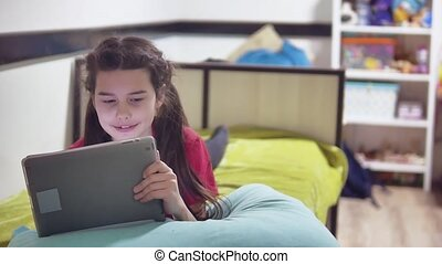 girl child teen plays in a tablet online game. girl social...