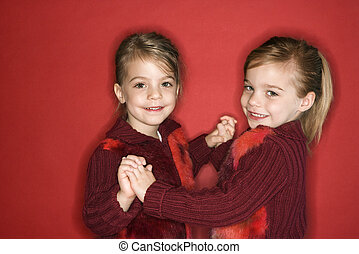 Girl child twin sisters dancing. - Female children Caucasian...