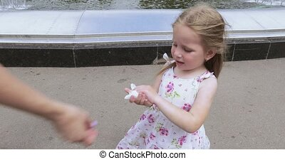 Girl child wipes his hands with a wet napkin - The park girl...